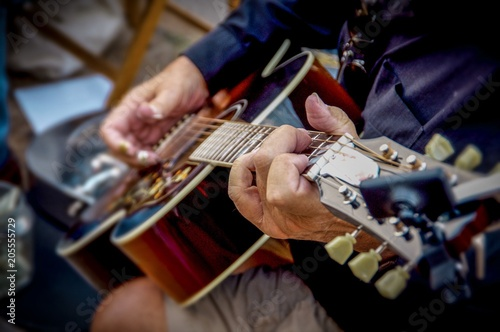Wrinkled hands of man holding and play guitar Canvas Print
