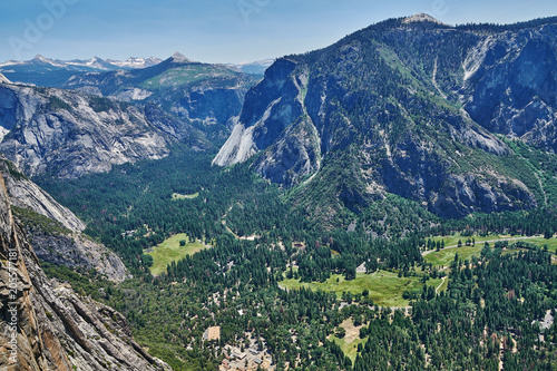 View of the Yosemite Valley with Visitor Center and the Sierra Nevada mountain r Poster