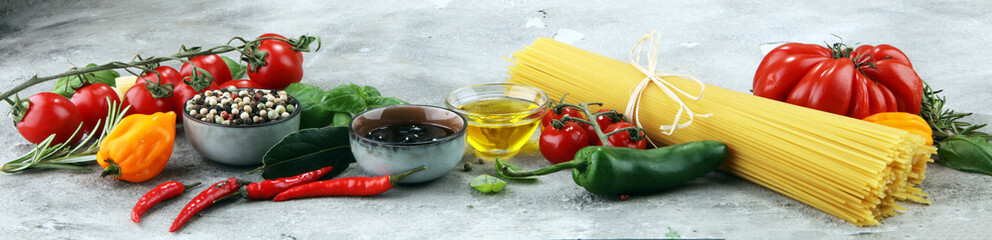 Fototapeta Przyprawy Italian food background with different types of pasta, health or vegetarian concept.