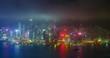 Aerial timelapse of illuminated Hong Kong skyline. Hong Kong, China