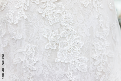 Fotografia, Obraz  Macro closeup of lace wedding dress veil material, white garment textile with sh