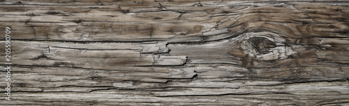 Poster Bois Old Dark rough wood floor or surface with splinters and knots. Square background with flooring or boards with wood grain. Old aged timber in a barn or old house.