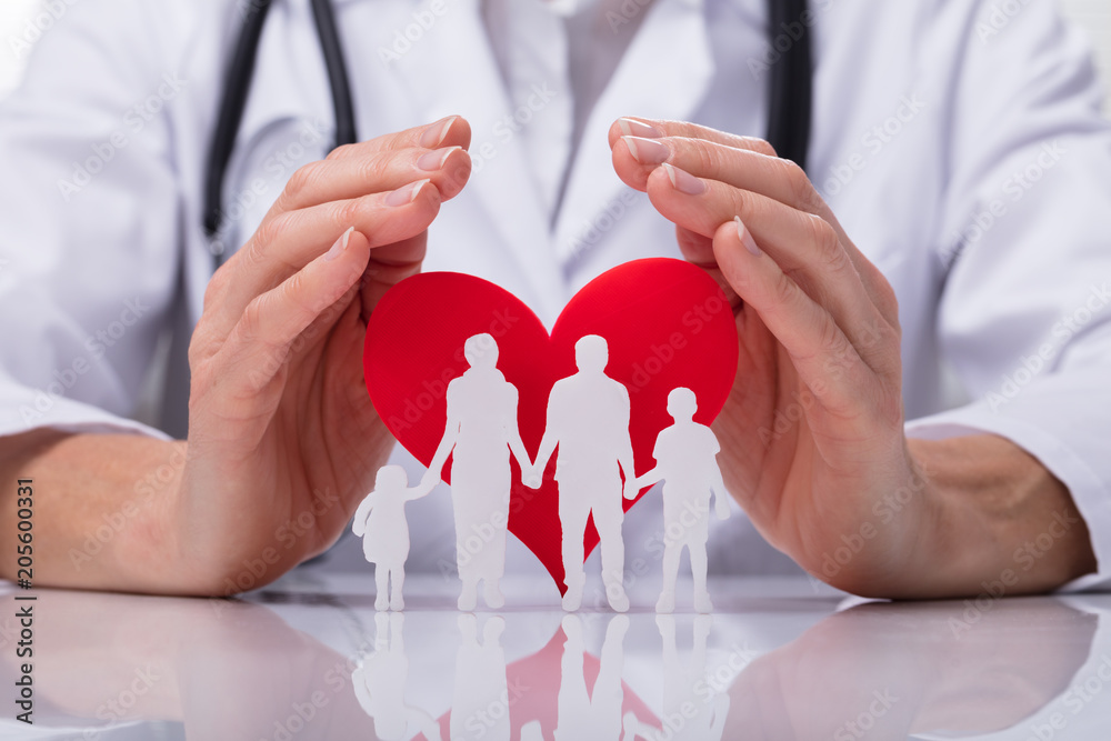 Fototapeta Doctor Protecting Family Cut Out With Heart Shape