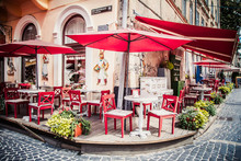 Lviv Outdoor Cafe With Red Umbrellas