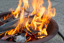 Wood Burning Brightly In A Met...