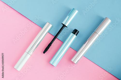 Valokuvatapetti Set of mascara for eyelashes on colorful pink and blue background