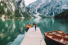 Beautiful Modern Couple Near A Lake In The Mountains Make Wedding Photos