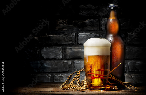 Photo  Beer in glass and bottle