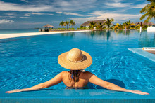 Woman With Hat At Beach Pool In Maldives