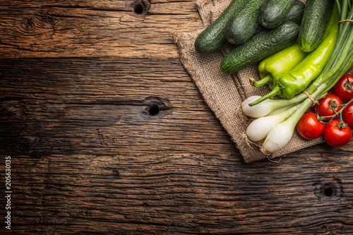 Stampe  Fresh vegetable onion cucumber pepper and tomatoes on rustic oak table