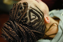Thin Braids On The Head With D...