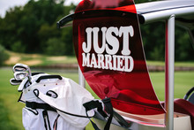 Just Married Sign On Red Heart On Empty Golf Cart Outdoors. Wedding Concept. Golf Car On Golf Course, Copy Space. Golf Club