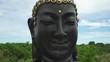 Slider shot of Buddha face, Buddha head sculpture.