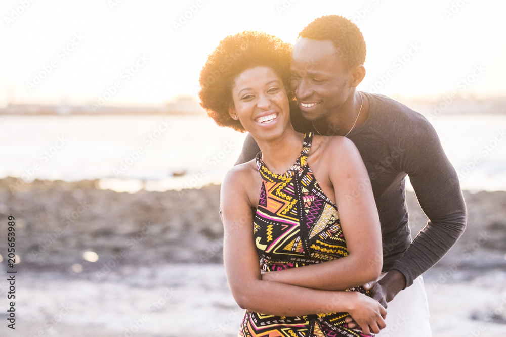 Fototapety, obrazy: black race african afroamerican couple in relationship or partnership or friendship touching and enjoying the sunset on the beach in vacation outdoor leisure time