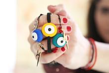 Girl Holding Evil Eye Bracelet...