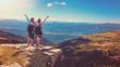Leinwandbild Motiv two women standing on the top of a mountain with wonderful view