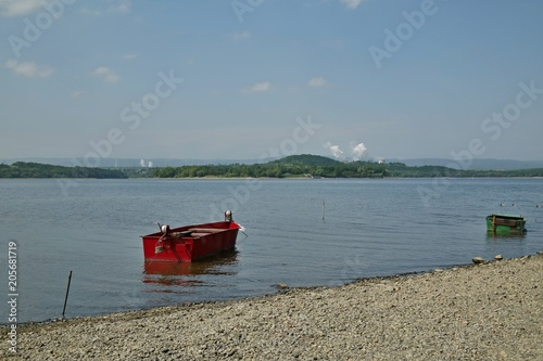 Landscape with Nechranice dam, Czech Republic, sandy coastline with pebbles, red Poster