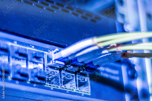 Fotografie, Obraz  Optical Internet and network yellow wires is on the manager switches