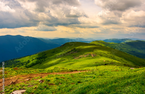Montage in der Fensternische Gebirge beautiful mountain landscape with grassy hills. sky with fluffy clouds. foot path in to the distance