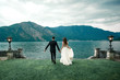 canvas print picture - wedding couple the background of the lake and mountains