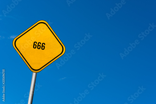 Photo  666 - yellow sign with blue sky