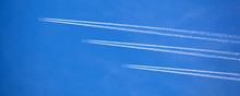 Huge Passenger Planes Fly High In The Sky One Behind Another