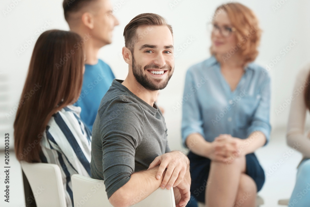 Fototapety, obrazy: Handsome man at group psychotherapy session indoors