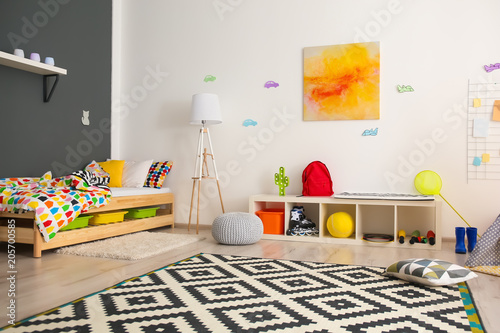 Modern room interior with comfortable bed for child