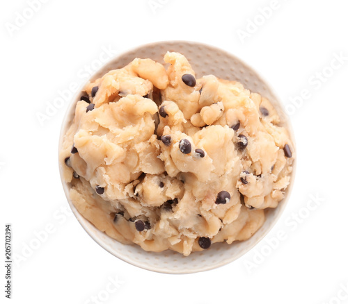 Raw cookie dough with chocolate chips in bowl on white background, top view
