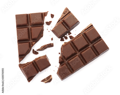 Delicious black chocolate on white background, top view