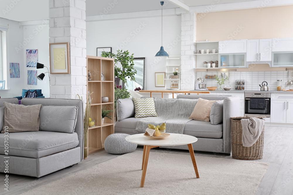 Fototapeta Stylish apartment interior with modern kitchen. Idea for home design