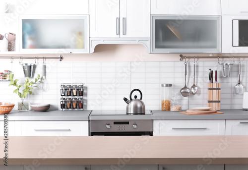 Foto  Stylish kitchen interior in apartment. Idea for home design