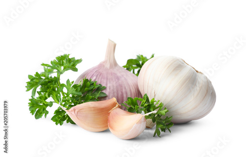 Green fresh parsley with garlic on white background