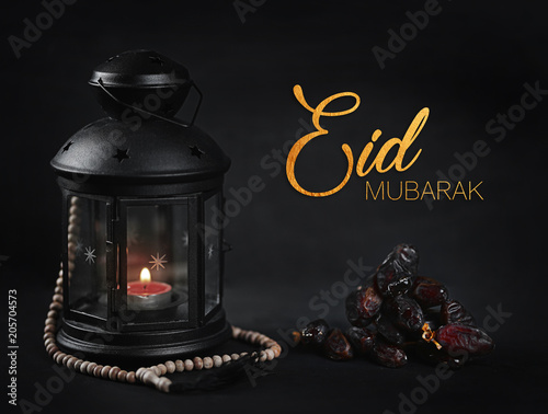Eid Mubarak Greeting Gold Typography. Ramadan Candle Lantern with Wooden Prayer Beads and Dates