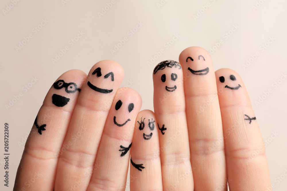 Fototapety, obrazy: Fingers with drawings of happy faces against light background. Unity concept