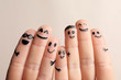 canvas print picture - Fingers with drawings of happy faces against light background. Unity concept