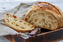 Cut Loaf Of Artisanal Wheat Bread On Sourdough.