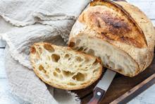 Cut A Loaf Of Artisanal Bread On Sourdough.