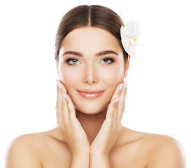 FototapetaFace Beauty Skin Care, Woman Natural Make Up, Model Isolated over White Background Touch Cheeks by Hand, Flower in Hair