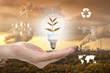 save earth concept, human hand holding light bulb on Industrial background