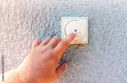 Obraz na plátně  hand ringing on doorbell