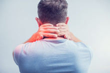 People, Healthcare And Problem Concept - Close Up Of Man Suffering From Neck Pain Over Gray Background