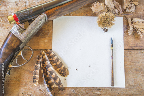 Fotobehang Jacht Hunting stories concept: hunting rifle, target upsite down, pheasant feathers on old wooden background top view