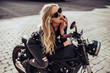 canvas print picture - Woman with black motorcycle