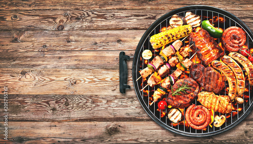 Fotografie, Obraz  Assorted delicious grilled meat and bratwurst with vegetables on grill