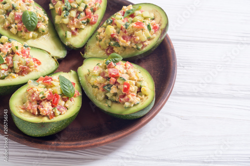 Avocado stuffed with cucumber , tomatoes and eggs