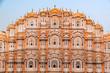 Leinwanddruck Bild - Hawa Mahal on a sunny day, Jaipur, Rajasthan, India. An UNESCO World heritage. Beautiful window architectural element.