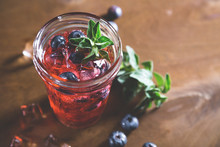 Natural Lemonade With Fresh Blueberries And Herbs