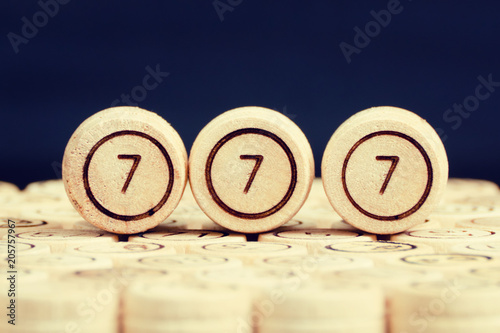 Fotografia  Lucky number 777 on the wooden keg lotto