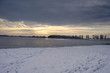 frozen lake in winter at sunset